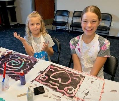 Two kids finger painting